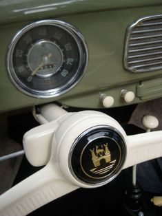 Wolfsburg Crest on the horn of a 1956 Volkswagen Beetle.  I used to stare at the one on the shifter of my grandmother's Beetle and wonder where the dragon was...