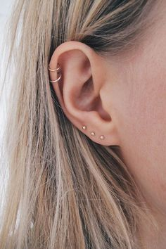Very Small Gold Stud Earrings - Very Tiny Gold Studs - Gold Studs - Subtle Gold Studs - Solid Gold Studs - Minimal Studs - jewellery UK These tiny studs are perfect for ears that have more than one piercing as theyre small enough to look delicate going Ear Peircings, Cute Ear Piercings, Ear Piercings Cartilage, Cartilage Hoop, Multiple Ear Piercings, Different Ear Piercings, Septum Piercings, Piercings For Small Ears, Unusual Piercings