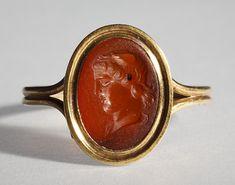 Head of Medusa. Graeco-Roman ringstone, 30 BC-200 Cornelian, gold (modern gold ring). 1,2 x 0,9 cm Inventory number: I765