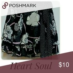 """Heart Soul Tiered Mini-Skirt Black White Size M Item PMTC -0137  Feminine and frilly two-tier skirt in a mixed media design.  It is partially polka-dot and partially floral print in colors of pink,black, and white.  Fully lined with a self-tie. Measurements taken while garment was laying flat and doubled.  All measurements approximate. Waist 30"""" around . Hips 35"""" around. Length from waist to hem 15"""". HeartSoul Skirts Mini"""