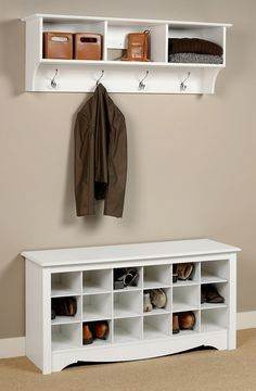 This shoe organizer doubles as a bench. Perfect for a mudroom or entryway