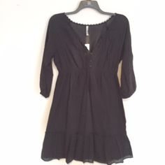 """Black Peasant Style Dress Black style peasant dress. All measurements are done lying flat without stretching.  Bust: 21"""" lying flat armpit to armpit. Waist: 15"""" has elastic, stretches up to 22"""". Length: 36"""" top of shoulder to bottom hem.  Skirt is lined, the top is not, you will need a Cami underneath. Old Navy Dresses"""