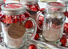 1.  Homemade Hot Chocolate Mix recipe from Simple Organized Living (i didn't use the powdered milk) 2.  mason jar mugs  3.  canning jar lids  4.  thin wrapping paper  5.  gift tags  6.  mini red ornaments  7.  Andes peppermint chips 8.  chocolate chips 9.  marshmallows