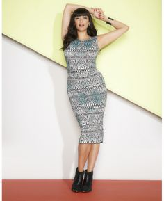 love the print with splashes of mint - and the midi length, of course