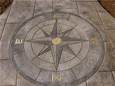 residential walkway created with concrete stamps and dyes. -- #nautical, compass rose