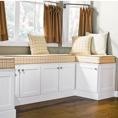 Use basic cabinets for this custom looking project. The window seat made out of stock kitchen cabinets!