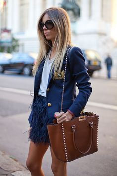 STREET STYLE SPRING 2013: PARIS FASHION WEEK - A feather skirt lends a flirty feel.