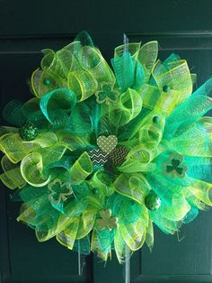 Are you looking for a green wreath for Saint Patricks Day?? This 23 inch Saint Patricks Day wreath has many shades of green with many shamrocks