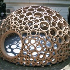 This is an Appolonian sphere dome. It is composed of cross sections of cones made of cardboard. The photo was gleaned from Inhabitate.com