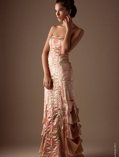 The L'Arbre Rose Dress from Wai-Ching is so elegant and whimsical.  Its non-traditional color and art-deco inspirations make it unique and perfect for my imaginary wedding.