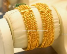 Pair of latest designer 22 carat gold broad bangles from PMJ Jewels.The plain gold bangles set in a weaved design complimented with small gold bits throughout the edges. Gold Bangles Price, Plain Gold Bangles, Gold Bangles Design, Gold Earrings Designs, Gold Jewellery Design, Gold Jewelry, India Jewelry, Temple Jewellery, Jewelry Shop