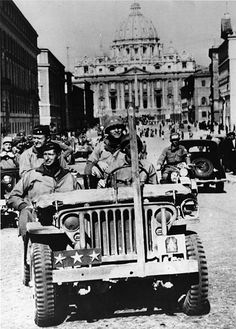 American General Mark Clark in his 3star jeep rides through Rome following the liberation of the city by the 5th Army June 1944 Behind him sits Major...