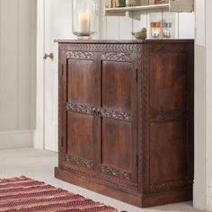 The handcrafted details on this Sheesham wood Almirah make it an elegant yet durable addition to your home office or family room. Built with bold proportions and high quality this cabinet adds charm to your home.