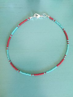 Teal and Red Handmade beaded anklet / layering anklets / delicate anklets / delicate jewelry / dainty anklets Diy Wire Jewelry Rings, Bead Jewellery, Cute Jewelry, Beaded Jewelry, Jewelery, Bracelet Patterns, Bracelet Designs, Beaded Anklets, Western Jewelry