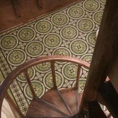 Combining a Cuban Encaustic Cement Tile Rug with rich, complex wood floors complements the surrounding decor, while adding historical interest with its pattern and colors. Wood, Tile Rug, Stone Design, Cement Tile, Tile Design, Residential Tile, Tile Installation, Encaustic Tile, Tile Patterns