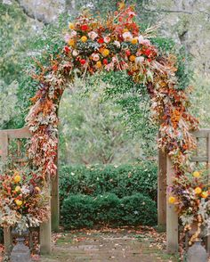"""The ceremony took place in a romantic garden of crepe myrtle trees that led to a wooden arbor. Janie Medley of JM Flora Design embellished the structure with fall blooms. """"I stopped dead in my tracks when I saw it for the first time. It brought tears to my eyes!"""" says Brittany."""