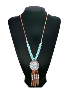 """This """"Oh Sweet Lariat Necklace"""" has brown lather tassel fringe, turquoise beading & silver pendant! Perfect for a festival or rodeo!"""