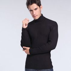 Who knows who this guy is, but one thing we do know is he's a turtleneck wearing hottie.