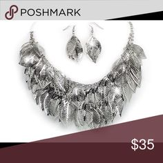 "Coming Soon!  Cascading leaves layered necklace. PRODUCT DETAILS Dozens of lovely 7/8"" silvertone leaves cascade from the double layers of this 18"" adjustable designer-style necklace with matching pierced wire earrings. Jewelry Necklaces"