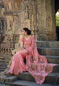Peach designer net Indian saree with thread work and heavy moti work blouse