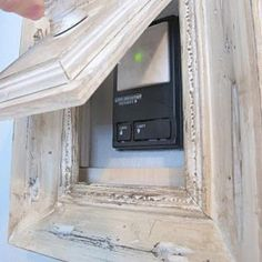 How to hide a thermostat, garage door opener or even wall switches!  Likey Likey!
