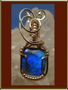 Opal pendant brilliant blue black opal.