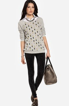 Absolutely love the blouse under a sweater look. Especially when said sweater has lipstick graphic all over it c/o Daily Look