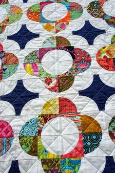 Cut to Pieces: A Quilter's Mixology in Review - Drunkard Path blocks like the planned scrappiness of the quilt.