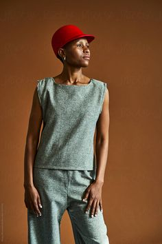 A South African woman wearing a red hat against a brown background Stylist: Bielle Bellingham Photographer: Micky Wiswedal Hat: Crystal Birch Red Hats, Female Portrait, African Women, Birch, Stylists, Women Wear, Crystal, Stock Photos, Woman