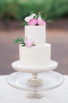 Pink floral topped wedding cake: http://www.stylemepretty.com/california-weddings/geyserville-california/2016/01/17/french-inspired-wine-country-wedding-at-geyserville-inn/ | Photography: Lori Photo - http://loriphoto.com/