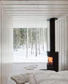 Tiny modern cabin, out of a shipping container? Love the little wood stove