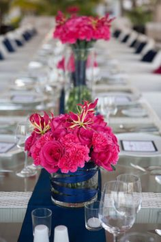 The ribbon and matching runner looks really elegant, plus bright pink flowers.. Plus I love these colors!.