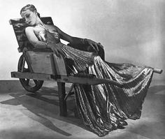 Artwork by Man Ray, Model in Lucien Lelong gown, seated in wheelbarrow by Oscar Dominguez, Made of Gelatin silver print Lee Miller, Madeleine Vionnet, Man Ray Photos, Lucien Lelong, Art Gallery Of Ontario, Photo Images, Art Images, Cecil Beaton, Photo D Art