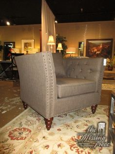 """The Westerly chair in a cool toned brown upholstery on dark feet. This chair has high button tufted arms and silver nailhead trim. So attractive! Ideal for a contemporary style space! 39""""wide x 33""""deep x 30""""high."""