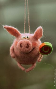 Pig ornament with lollipop