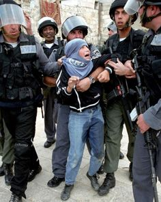 """Israeli soldiers and """"border police"""" arresting a Palestinian Child. Hundreds of Children are in Israeli jails"""