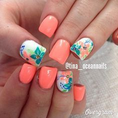 Paint your nails in pretty salmon and hibiscus designs. Matted in salmon, the rest of the nails are then coated in white polish and painted with a combination of aquamarine, sea green, salmon and blue. To add to the sophistication of the nail art a gold bead is placed on top.