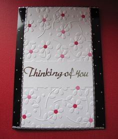 Floral 'Thinking of You' card with embossed white flowers with pink centres