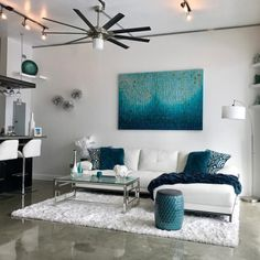 A large-scale hand-painted canvas instantly transforms this Florida loft with electric energy echoed throughout other accents. Get the look (and OFF all artwork & decor) at the link in our bio! Living Room Colors, Living Room Designs, Apartment Living Room, Couches Living Room, Rugs In Living Room, Living Room Grey, Home Decor, Room Decor, Apartment Decor