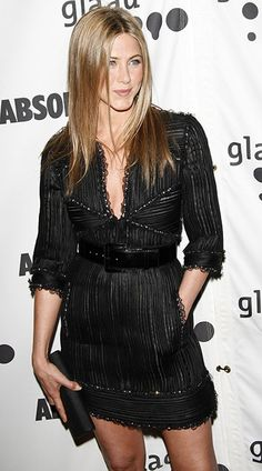 Jennifer Aniston's asymmetrical leather black dress hugs her figure in all the right ways.  octo-link.xyz/e12ea980