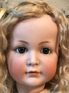"""This sweet doll wears her original mohair wig. She is marked as shown and at the very base of her neck she is marked 68 which is her size in centimeters making her 27"""" tall. She has a pull string crier which still works! 