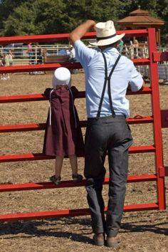 .An Amish man and little one take in the view at Yoder Heritage Day in Yoder, Kansas