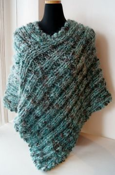 Knitted poncho...this is in another language, but perhaps one could make it according to the picture....