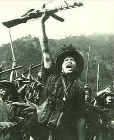 A popular photo of a Vietcong soldier raising his Soviet - PPSH 41 which is later on used to be a useful propagandic tool in exhorting for a war against America.