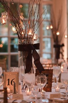 branch centerpeices with hanging candles