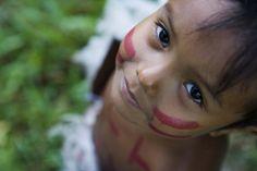 Amazon rainforest village, Brazil  Amazonian girl in Amazon rainforest village.
