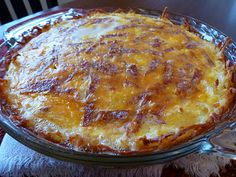 Quiche with Hash Brown Crust- 3 cups thawed hash browns 4 T melted butter 3 large eggs, beaten 1 c half-n-half 6 or 7 slices of cooked, cut up bacon (I used turkey bacon and cut it up with kitchen shears) 1 T dried minced onion 1 c cheddar cheese, shredded