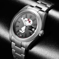 Through a unique collaboration Rodnik and BWD have created a humorous and highly collectable customized Snoopy Rolex Datejust watch. The watches are available in two designs, one in their MGTC Black and the other in their MGTC Light Grey. Each watch limited to a series of 25 and both comprising the qualities for which BWD has become renowned. Watch comes housed in distinctive Snoopy Doghouse presentation case. Please allow 6-8 weeks for shipping.