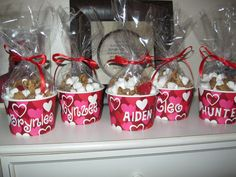 Valentine Treats for Toddlers!      Mini marshmallows, teddy grahams & cherry Ju Ju hearts in a bag and personalized paper treat cups.  Fun for the kids and nothing the parents have to keep around and trip over!