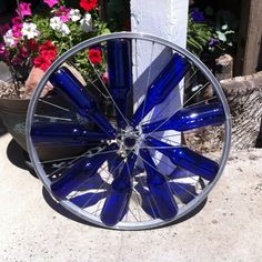 Bike wheel and wine bottles